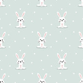 Cute white rabbit and tiny star seamless pattern. Lovely bunny on easter background.