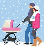 Cute young happy couple pushing stroller together