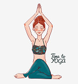 Cute, young woman practicing yoga, hands together