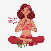 Cute, young woman practicing yoga, sitting in lotus position, hands together