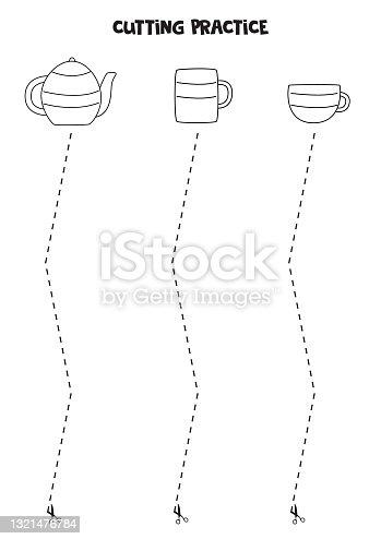 Prática de corte para crianças com bule de chá de cozinha e xícaras.