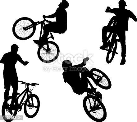 silhouette of male doing bike trick