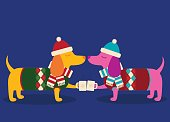 A vector illustration of two dapper dachshunds in sweaters toasting with hot cocoa. Objects are grouped and layered for easy editing.