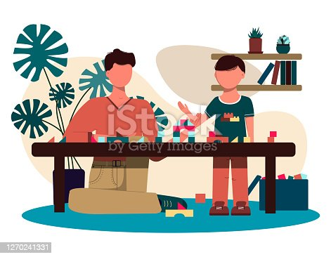 istock dad and son play together with the constructor. flat design. illustration of a man and a boy in a cozy interior with potted flowers, furniture and children s toys. Vector image of a family for father s day. 1270241331