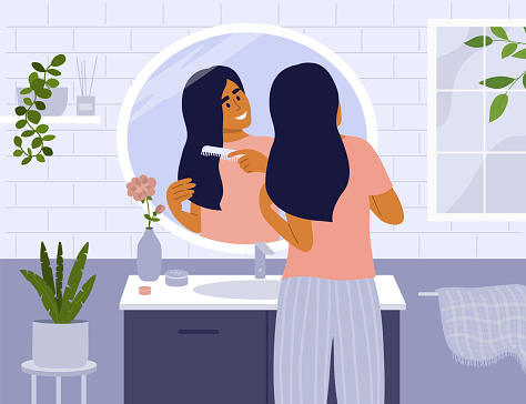 Daily morning routine concept with cute girl in bathroom combing hair