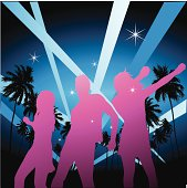 Silhouetted figures of young people dancing the night away with a tropical palm tree background with spot lights cutting through the night sky.