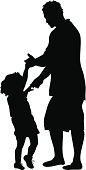 Little girl dances with father figure - silhouette