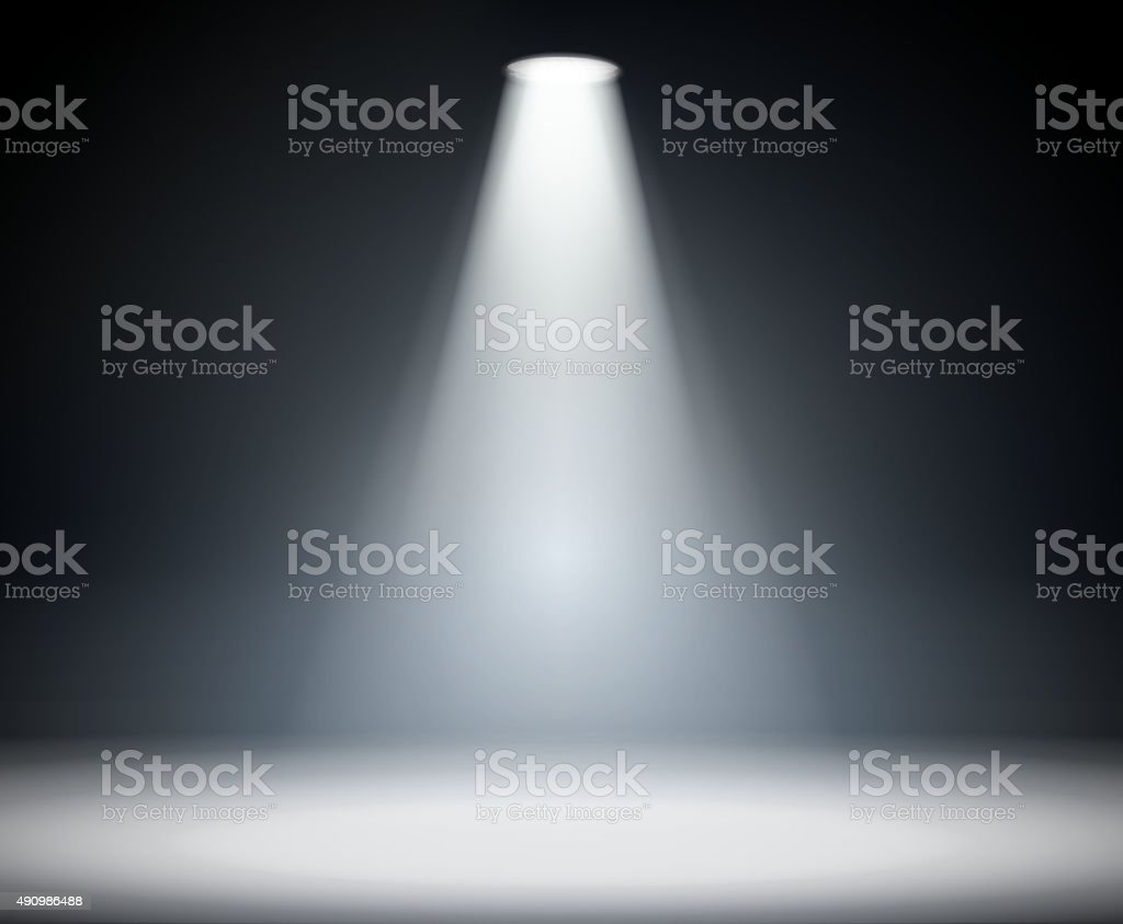 Dark background with spotlight. vector art illustration