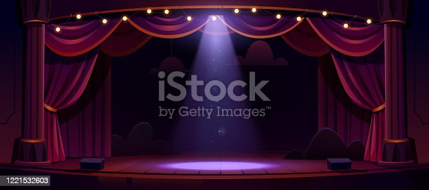 istock Dark theater stage with red curtains and spotlight 1221532603