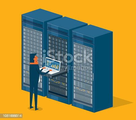 Businessman working on laptop in database center or server room