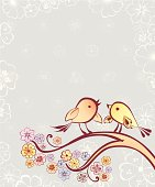 The vector image of two birds sitting on the blossoming branch.
