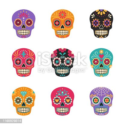 Vector collection of Mexican traditional sugar skulls in various colors. Isolated on white.