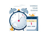 istock Daylight Saving Time ends concept. The hand of the clocks turning to winter time. Calendar with marked date, text Change your clocks. DST ends in usa, vector illustration in modern flat style design 1270707532