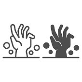 Dead man hand under ground line and solid icon, halloween concept, zombie hand breaking out from under ground sign on white background, corpse hand icon in outline style. Vector graphics