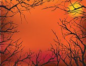 A Halloween background of dead trees and the moon