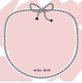 Decorative frame of rope with a bow on a light pink background.