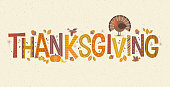 Decorative lettering Thanksgiving with seasonal design elements and turkey. For banners, cards, posters and invitations.