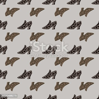istock Decorative seamless pattern with beige doodle women shoes silhouettes on blue background. 1290488275