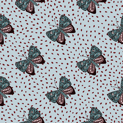 Decorative wildlife seamless pattern with folk butterfly ornament. Blue dotted background. Botanic theme.