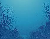 Silhouettes of various tropical fishes on a deep sea background. Des Silhouettes de poissons tropicaux et différents coraux se dessinent sous une mer profonde d'un bleu intense.