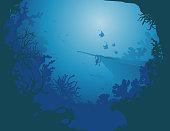 Silhouhette of a shipwreck  deep at the bottom of the sea with various tropical fishes and corals. Dans les profondeurs de la mer se dessine des silhouettes de poissons tropicaux, différents coraux et d'une épave de bateau.