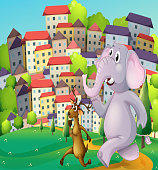 deer and an elephant running at the hilltop across the tall buildings