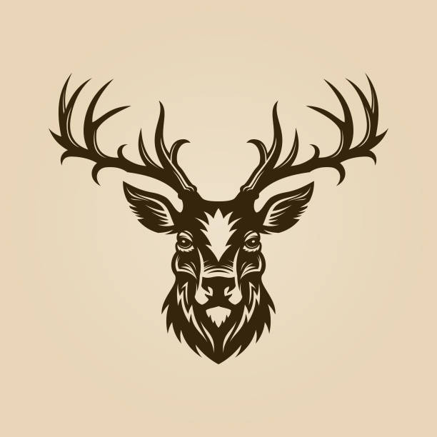 Deer head cut out silhouette. Horned elk or stag icon. Deer head cut out vector silhouette. Horned elk or stag icon. antler stock illustrations