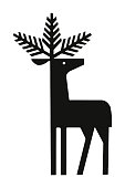 istock Deer with Evergreen Branches for Antlers 1003206716