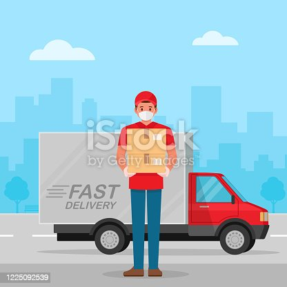 istock Delivery man with protective medical mask and delivery truck, during coronavirus covid-19 epidemic 1225092539