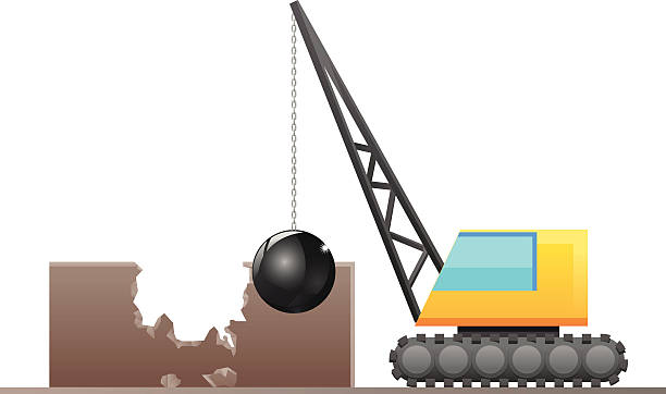 Demolisher destroying a building Vector illustration of a crane with large wrecking ball, demolishing a building structure. demolished stock illustrations
