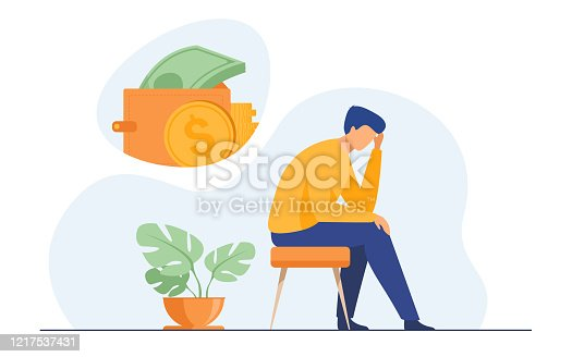 istock Depressed sad man thinking over financial problems 1217537431