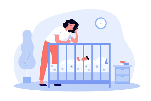 Depressed tired mom giving bottle to baby