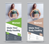 Design of a vector roll-up banner with diagonal and triangular elements and a place for photos. Template for sports, gym, personal trainer.