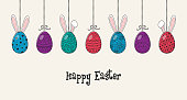 Design of an Easter decoration with decorative eggs with bunny ears and greetings. Vector
