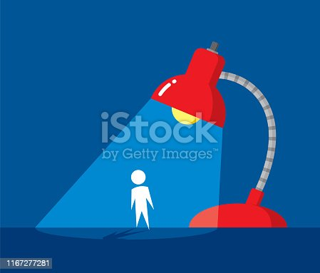 Vector illustration of a man standing under a desk lamp spotlight against a blue background in flat style.