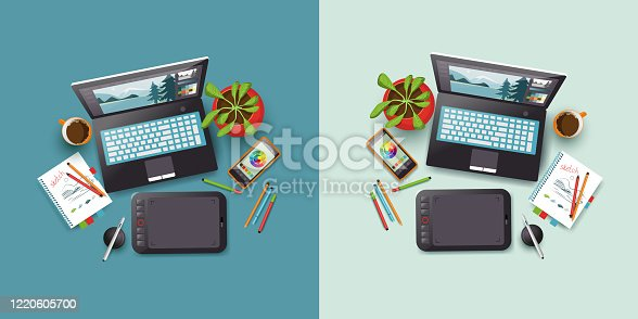 istock Desktop with laptop, phone, notepad and graphic tablet. Flat layer or top view. 1220605700