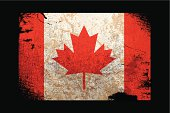 Detailed old grungy Canada flag over black