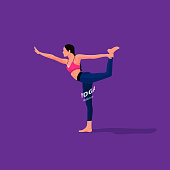 Slim girl is practicing yoga ,keeping balance with one leg.  Yoga templete and for some background of GYM.