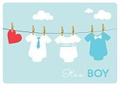 different baby bodysuits on light blue background