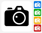 Digital Camera Icon. This 100% royalty free vector illustration features the main icon pictured in black inside a white square. The alternative color options in blue, green, yellow and red are on the right of the icon and are arranged in a vertical column.