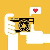 Digital camera in human hand,vector illustration.