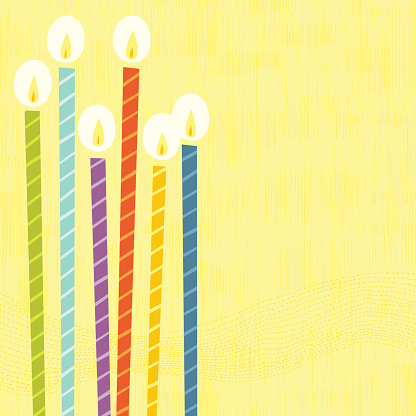 A digital image of six colorful lit birthday candles