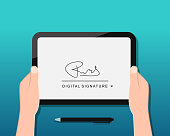 Digital signature concept with hands holding device