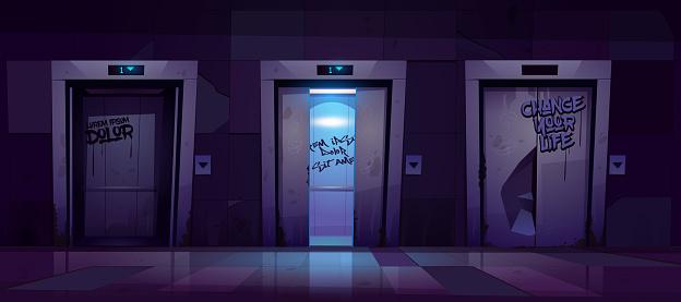 Dirty hallway with broken elevator doors at night