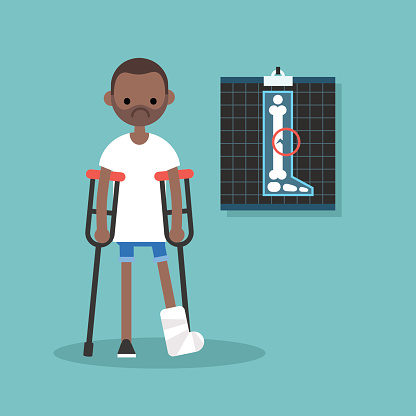 Disabled black man on crutches with broken leg