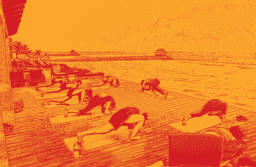 Discovering Mexico. Women enjoying yoga class on the beach at a Mayan Riviera tourist resort