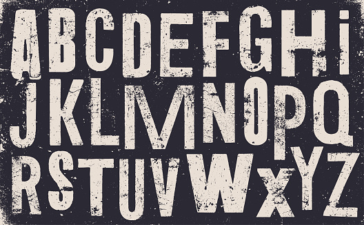 Vector distressed old uppercase alphabet. White letters on black weathered texture background. Grunge and weathered capital letters.