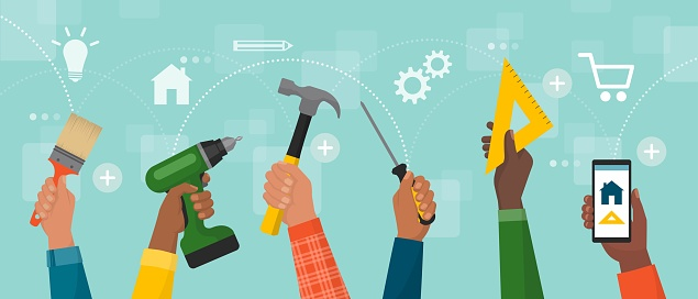 Diverse hands holding DIY tools and smartphone