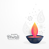 diwali festival greeting with diya and paisley decoration design