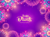 Happy Diwali with luminous flower Rangoli and fireworks. Indian festival of lights.